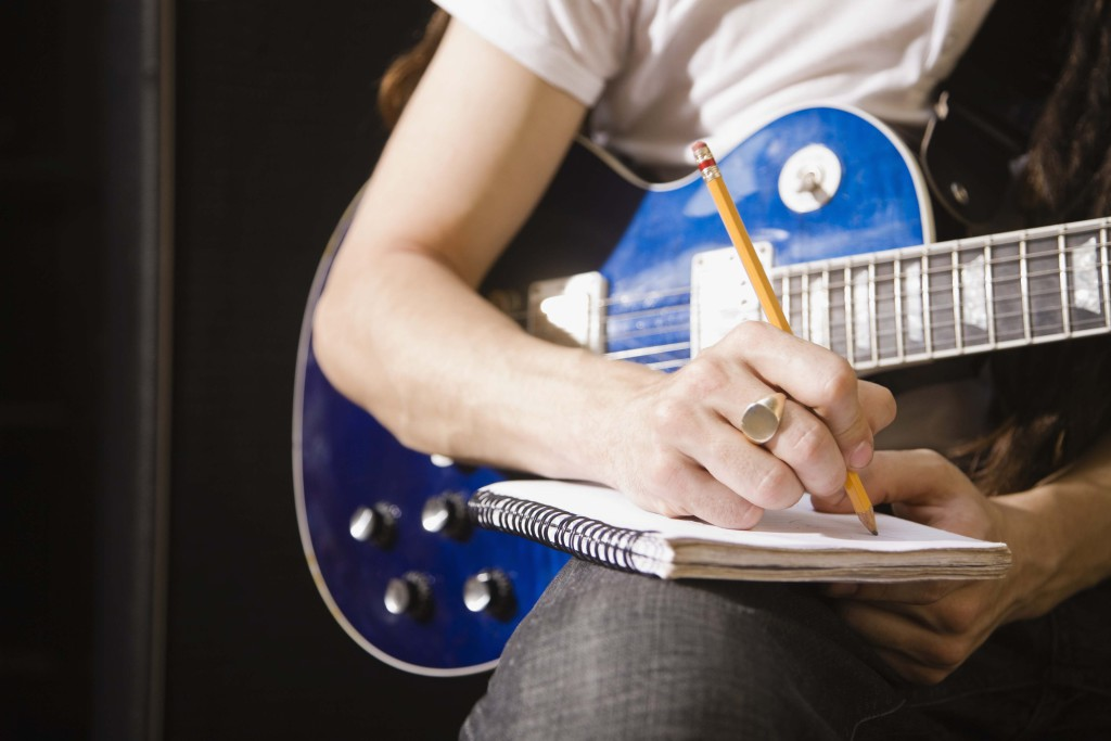 Man writing song